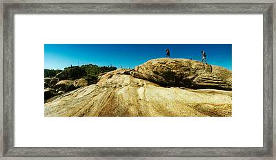 People Hiking Along The Boulders That Framed Print by Panoramic Images