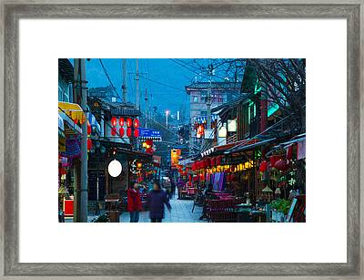 People In A Market At The Backpacker Framed Print by Panoramic Images
