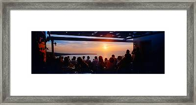 People Looking At Sunset, Santorini Framed Print by Panoramic Images