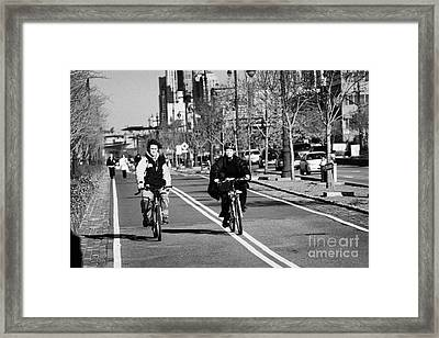 people mountain bikes exercising on bikeway next to West Side Highway new york Framed Print
