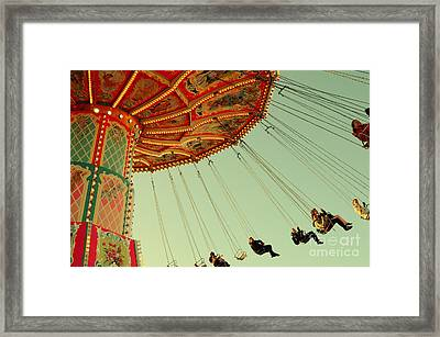 People On A Vintage Carousel At The Octoberfest In Munich Framed Print