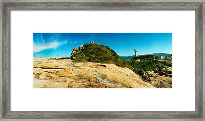 People On Boulders That Separate Framed Print by Panoramic Images