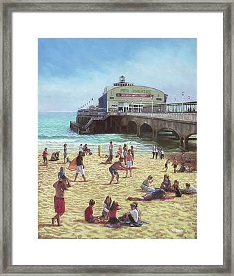 people on Bournemouth beach Pier theatre Framed Print