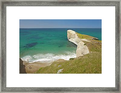 People On Cliff Top At Tunnel Beach Framed Print by David Wall