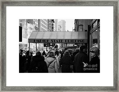 People On The Sidewalk Beneath The Entrance To The Empire State Building On Fifth Avenue New York Framed Print