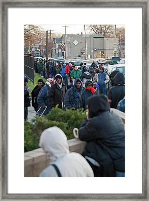 People Queuing At A Food Bank Framed Print