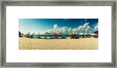 People Relaxing Under Umbrellas Framed Print by Panoramic Images