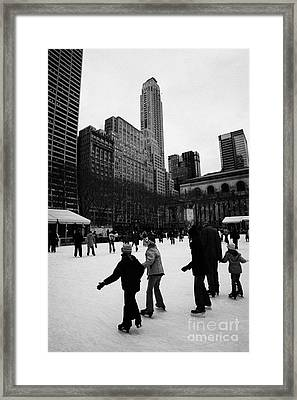 people skating on the ice at Bryant Park ice skating rink new york city Framed Print by Joe Fox