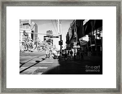people waiting to cross at intersection on south Las Vegas boulevard strip Nevada USA Framed Print by Joe Fox