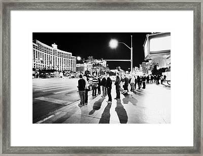 People Waiting To Cross Las Vegas Boulevard Outside The Bellagio And Paris At Night Nevada Usa Framed Print by Joe Fox