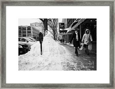 people walking along clear sidewalks in downtown city street Saskatoon Saskatchewan Canada Framed Print