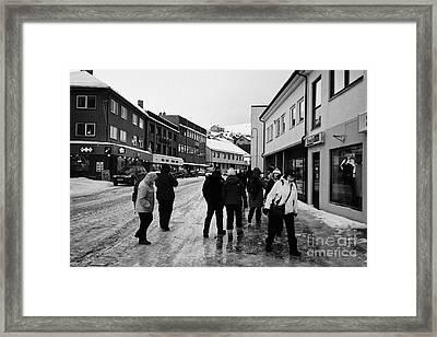 people walking along ice covered storgata main shopping street Honningsvag finnmark norway europe Framed Print by Joe Fox
