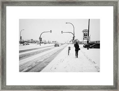 people walking and cars travelling along 8th street in blizzard conditions Saskatoon Saskatchewan Ca Framed Print by Joe Fox