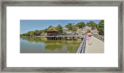 People Walking On Bridge Over A Pond Framed Print