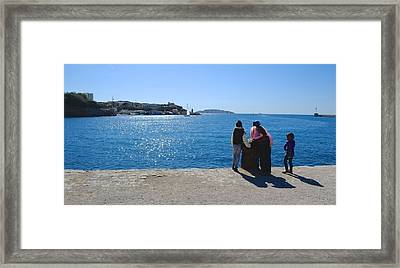 Family Watching The Sea  Framed Print