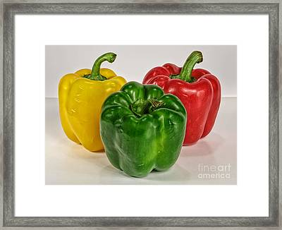 Peppers Together Framed Print by Mitch Johanson
