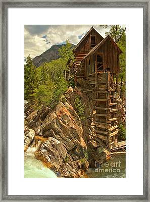 Perched On The Edge Framed Print by Adam Jewell