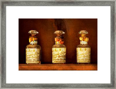 Perfumery - Perfume Framed Print by Mike Savad