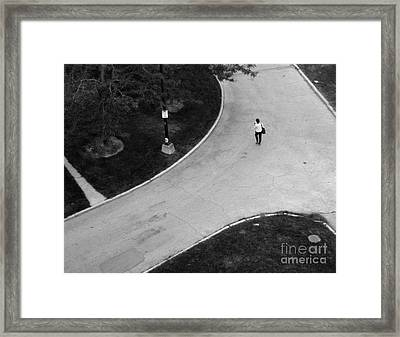 Person On Walkway Framed Print
