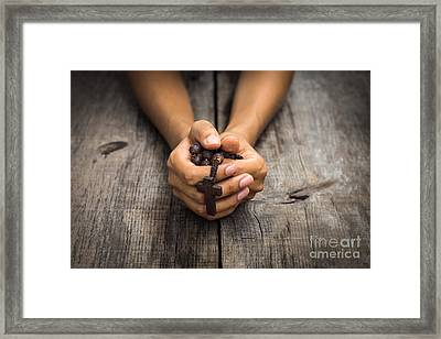Person Praying Framed Print by Aged Pixel