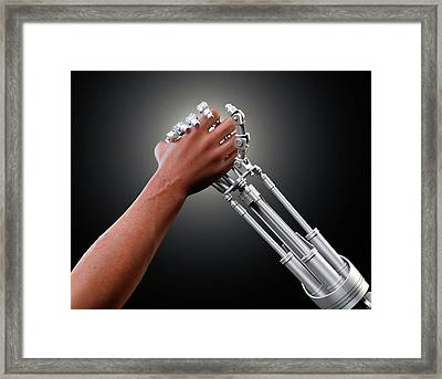 Person Shaking Hands With Robot Framed Print by Andrzej Wojcicki