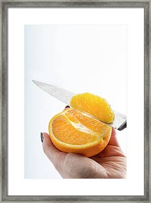 Person Slicing An Orange Framed Print