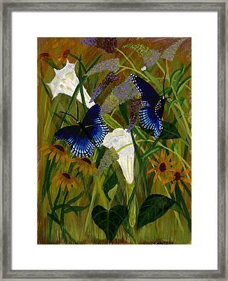 Perusing The Flowers Framed Print by Susan Schmitz