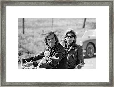 Peter Fonda And Nancy Sinatra On A Motorcycle Framed Print