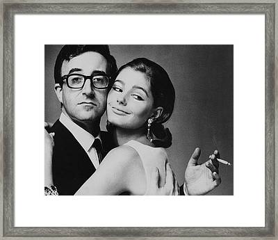 Peter Sellers Posing With A Model Framed Print