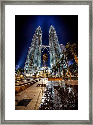 Petronas Twin Towers Framed Print by Adrian Evans