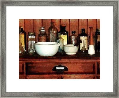 Pharmacist - Cabinet With Mortar And Pestles Framed Print by Susan Savad