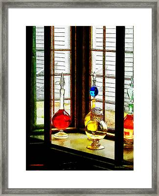 Framed Print featuring the photograph Pharmacist - Colorful Bottles In Drug Store Window by Susan Savad