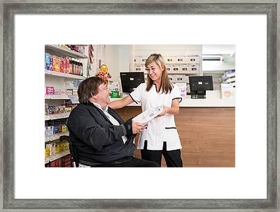 Pharmacist Dispensing Medication Framed Print by Jim Varney