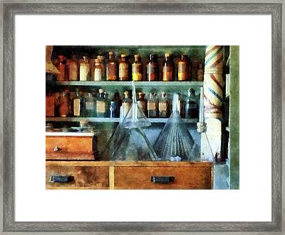 Pharmacist - Glass Funnels And Barber Pole Framed Print by Susan Savad