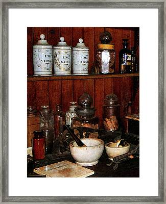 Pharmacist - Mortar And Pestles In Drug Store Framed Print