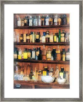 Framed Print featuring the photograph Pharmacist - Mortar Pestles And Medicine Bottles by Susan Savad