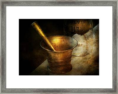 Pharmacist - The Pounder Framed Print by Mike Savad