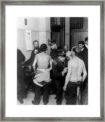 Physicians Examining Jewish Immigrants Framed Print