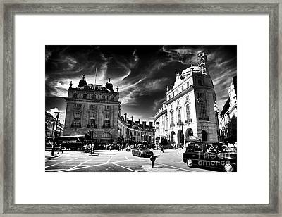 Piccadilly Circus Framed Print by John Rizzuto