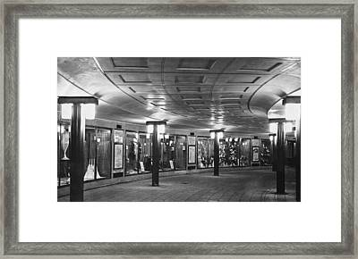 Piccadilly Circus Tube Station Framed Print by Underwood Archives
