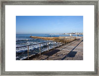 Pier And Promenade By The Atlantic Ocean In Cascais Framed Print