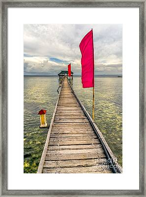 Pier Flags Framed Print by Adrian Evans