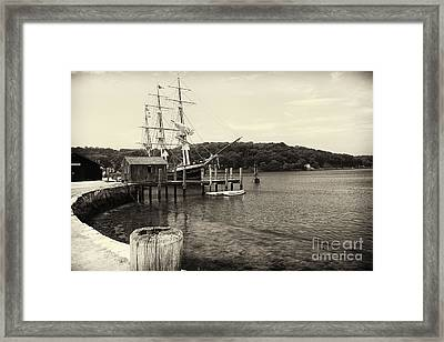Pier With A Tall Ship Framed Print by George Oze
