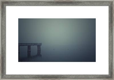 Piering Framed Print by Chris Fletcher