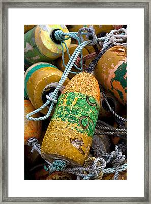 Pile Of Colorful Buoys Framed Print by Carol Leigh