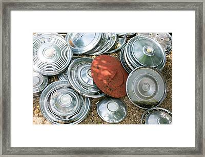 Pile Of Hubcaps, Tucumcari, New Mexico Framed Print by Julien Mcroberts