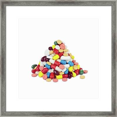 Pile Of Pills Framed Print by Geoff Kidd