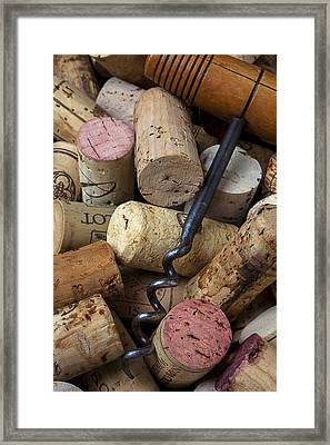 Pile Of Wine Corks With Corkscrew Framed Print by Garry Gay
