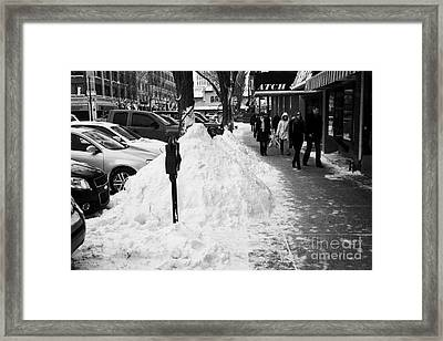 piles of snow cleared from downtown city street sidewalks Saskatoon Saskatchewan Canada Framed Print by Joe Fox