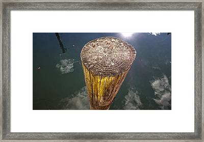 Piling Framed Print by David Stone